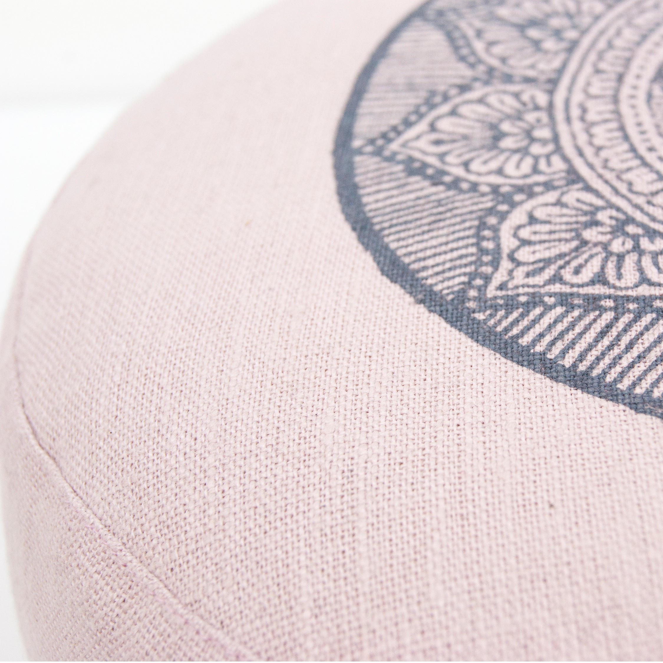 Close up fabric light pink mandala meditation cushions