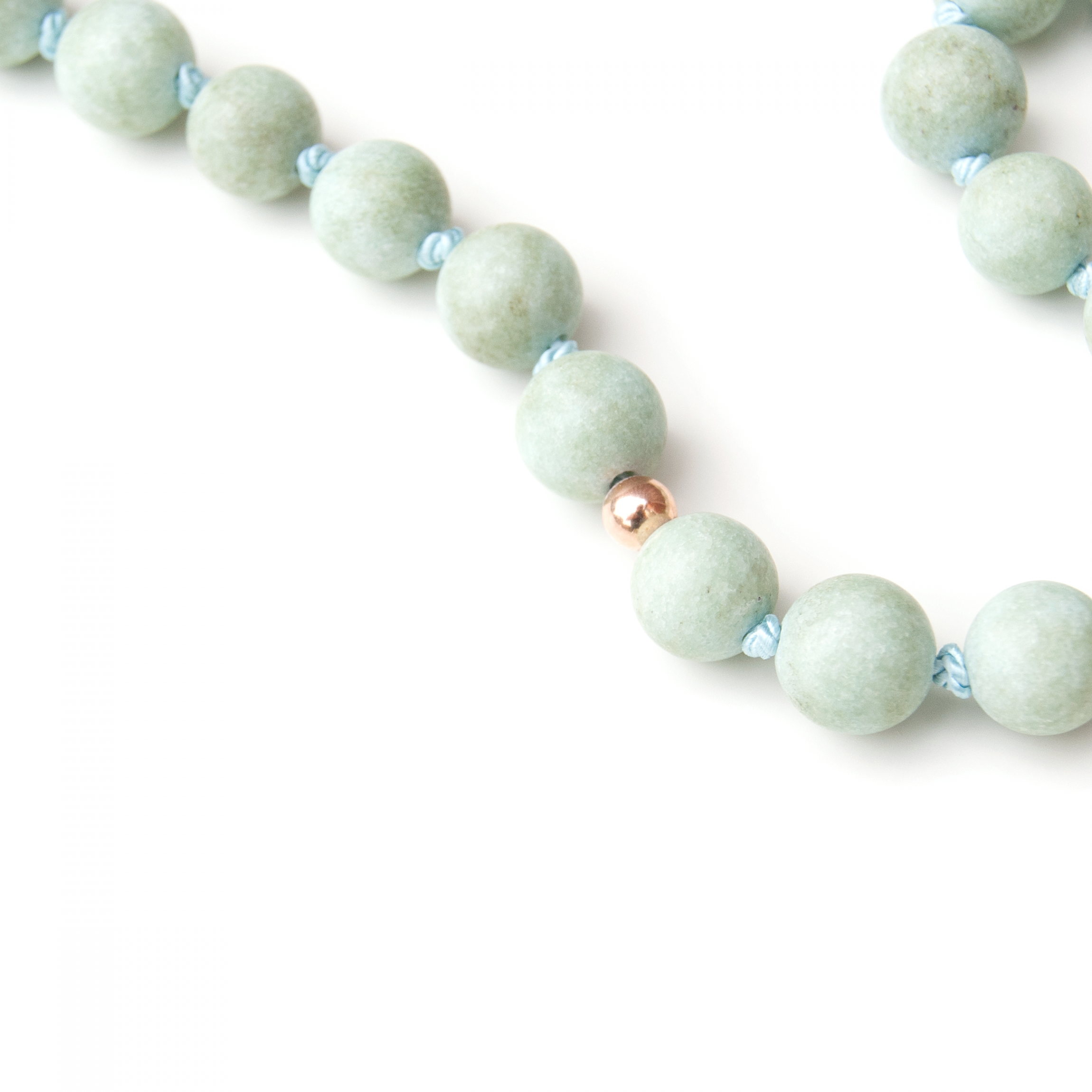 14k golden spacers on the Jade mala