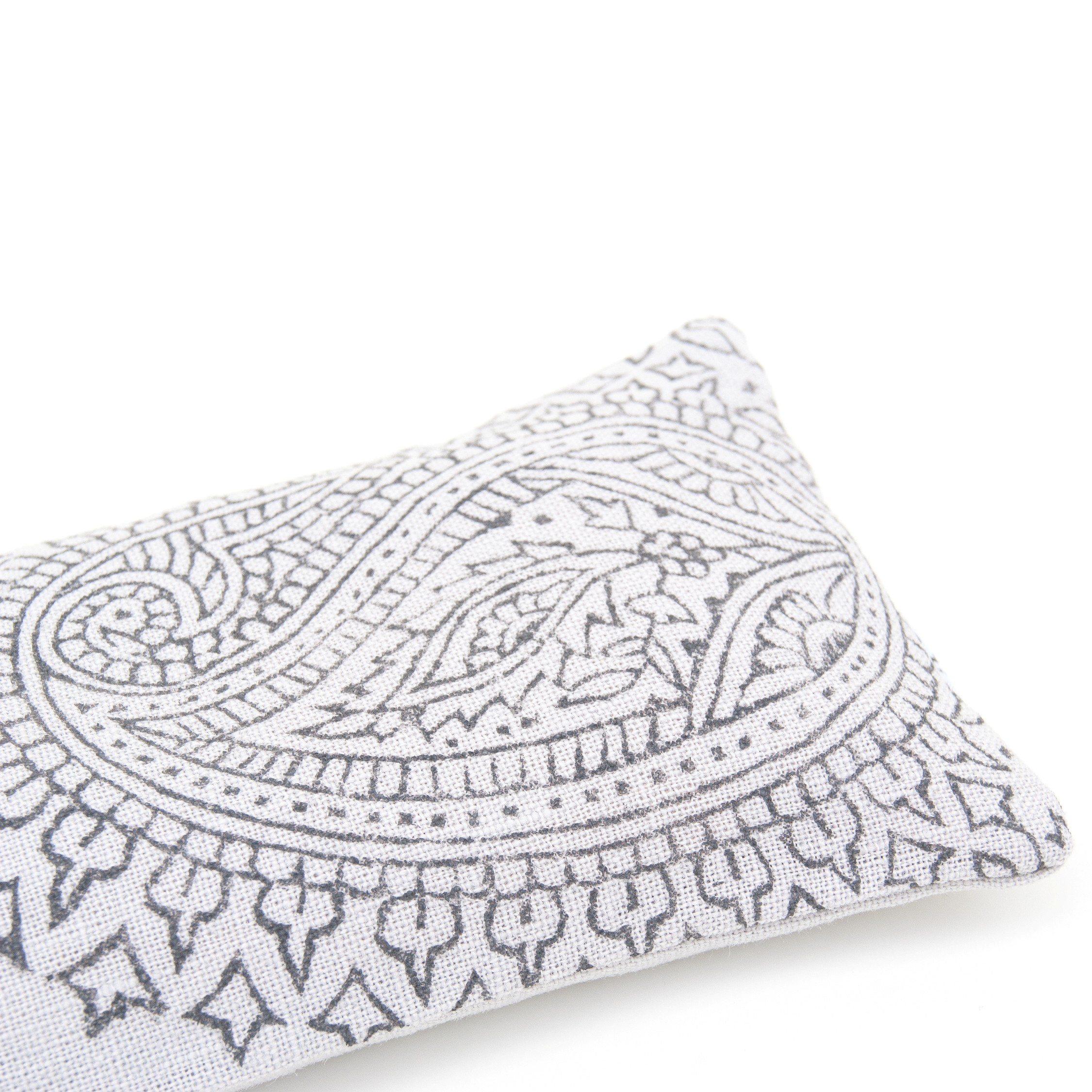 Close up of the light grey Paisly crystal eye pillow