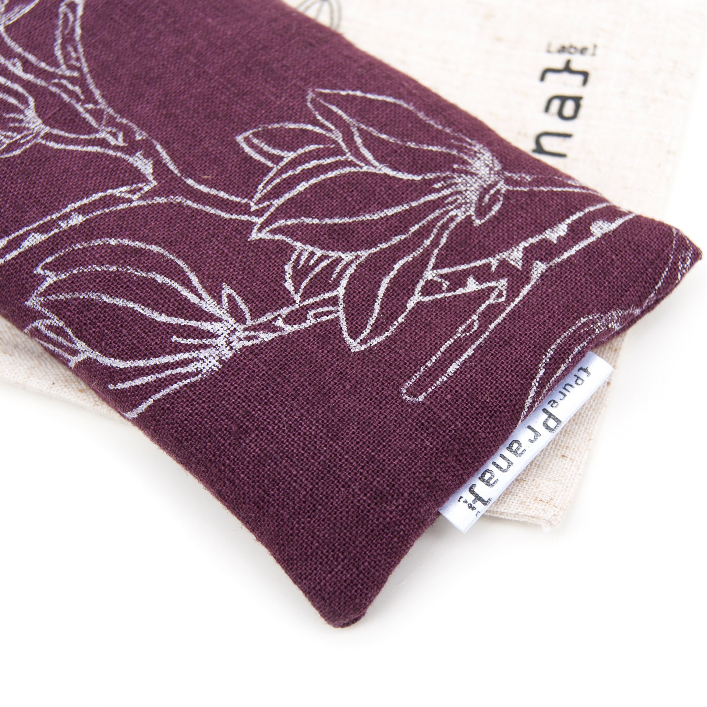 Close up of the eggplant eye pillow by Pure Prana Label
