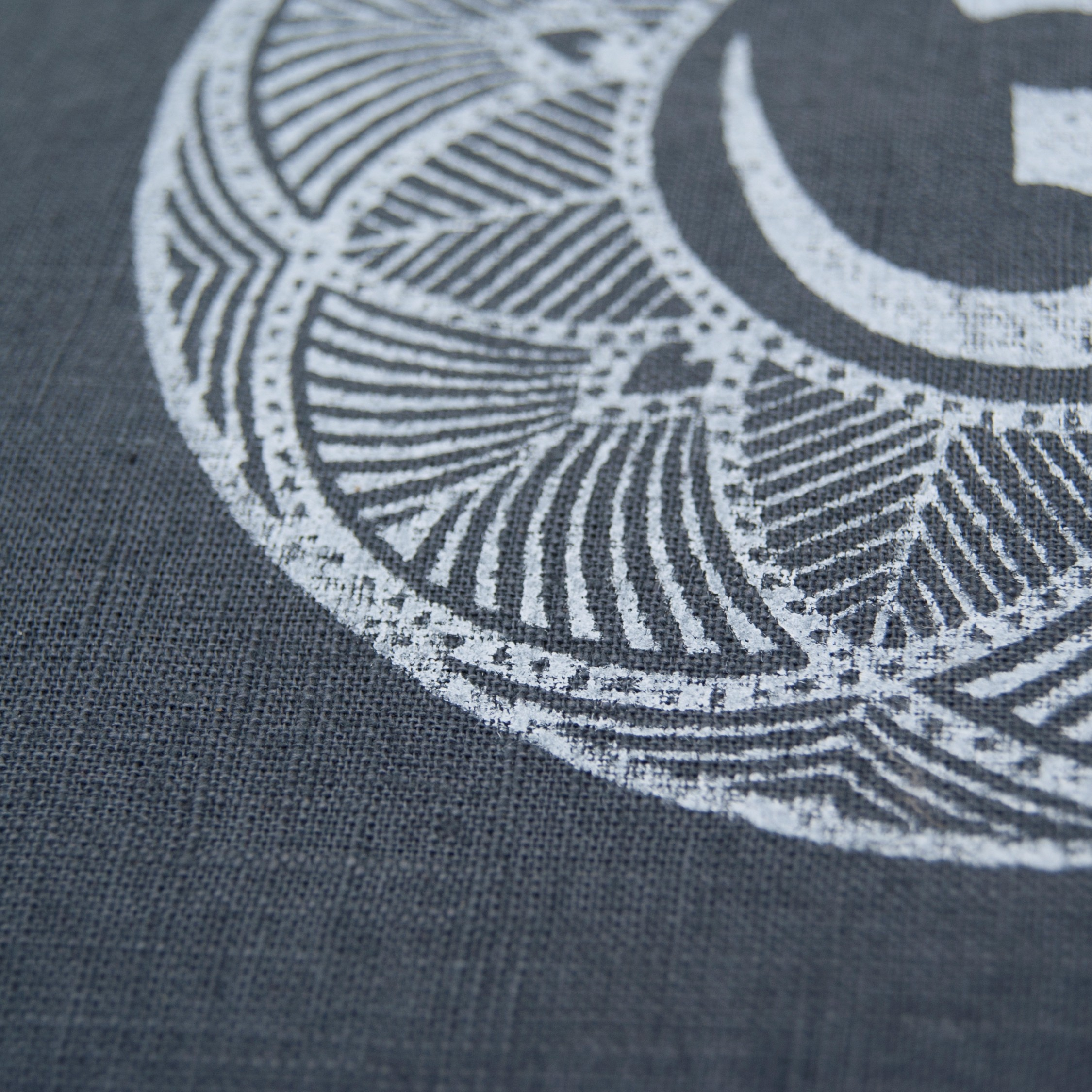 Close up print OHM meditation cushion