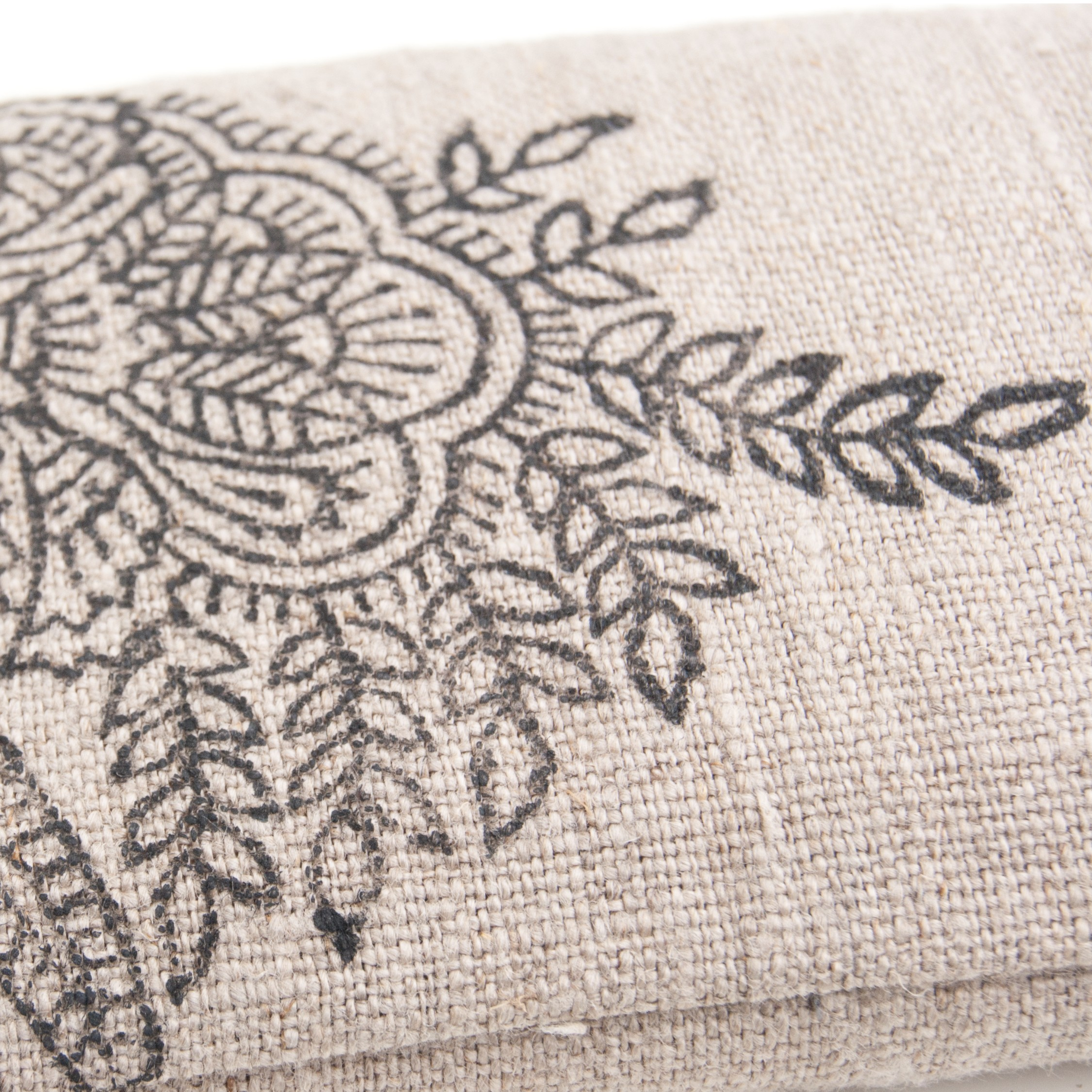 Handprinted flower on eye pillow by Pure Prana Label