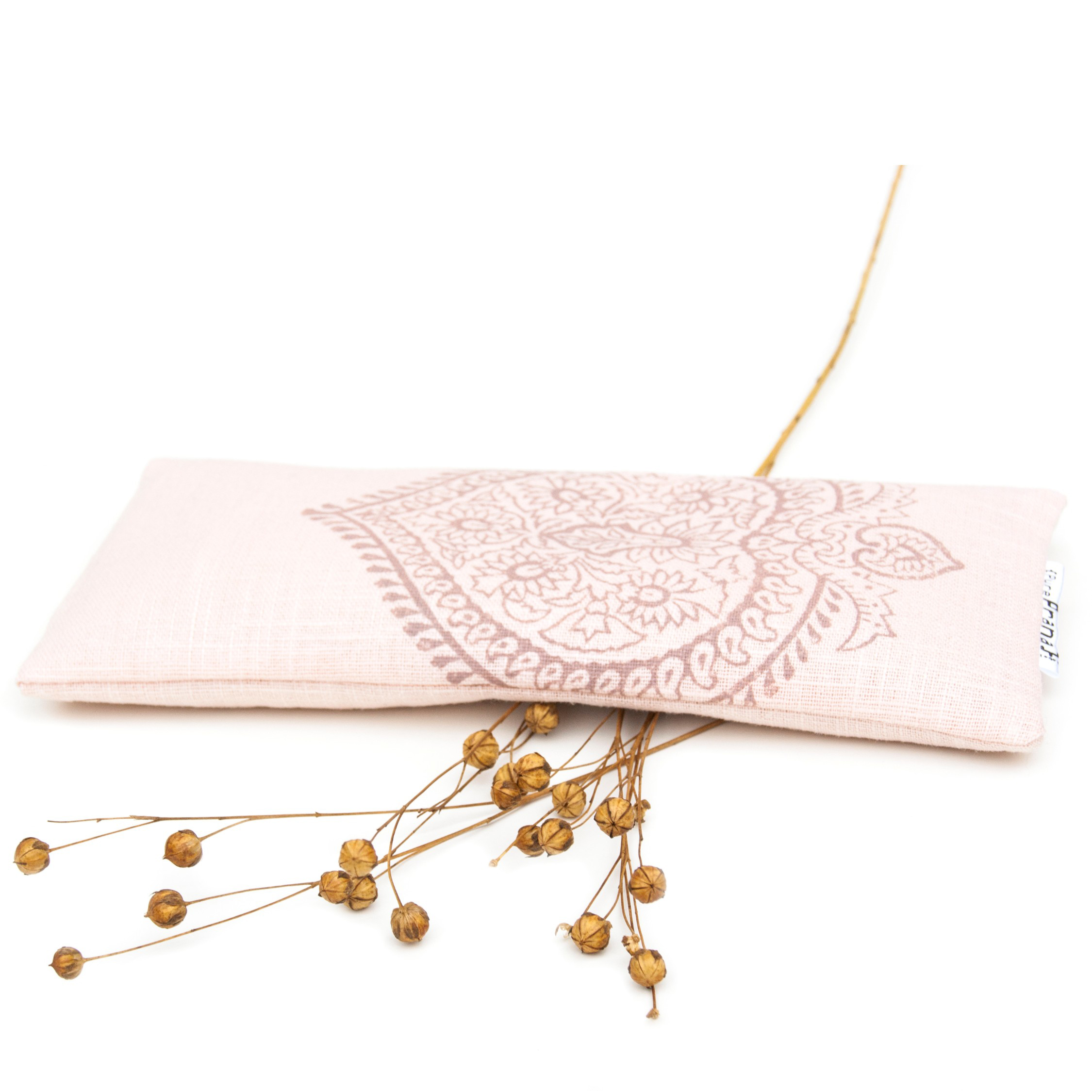 Pink eye pillow for yoga and meditation, filled with rose quartz