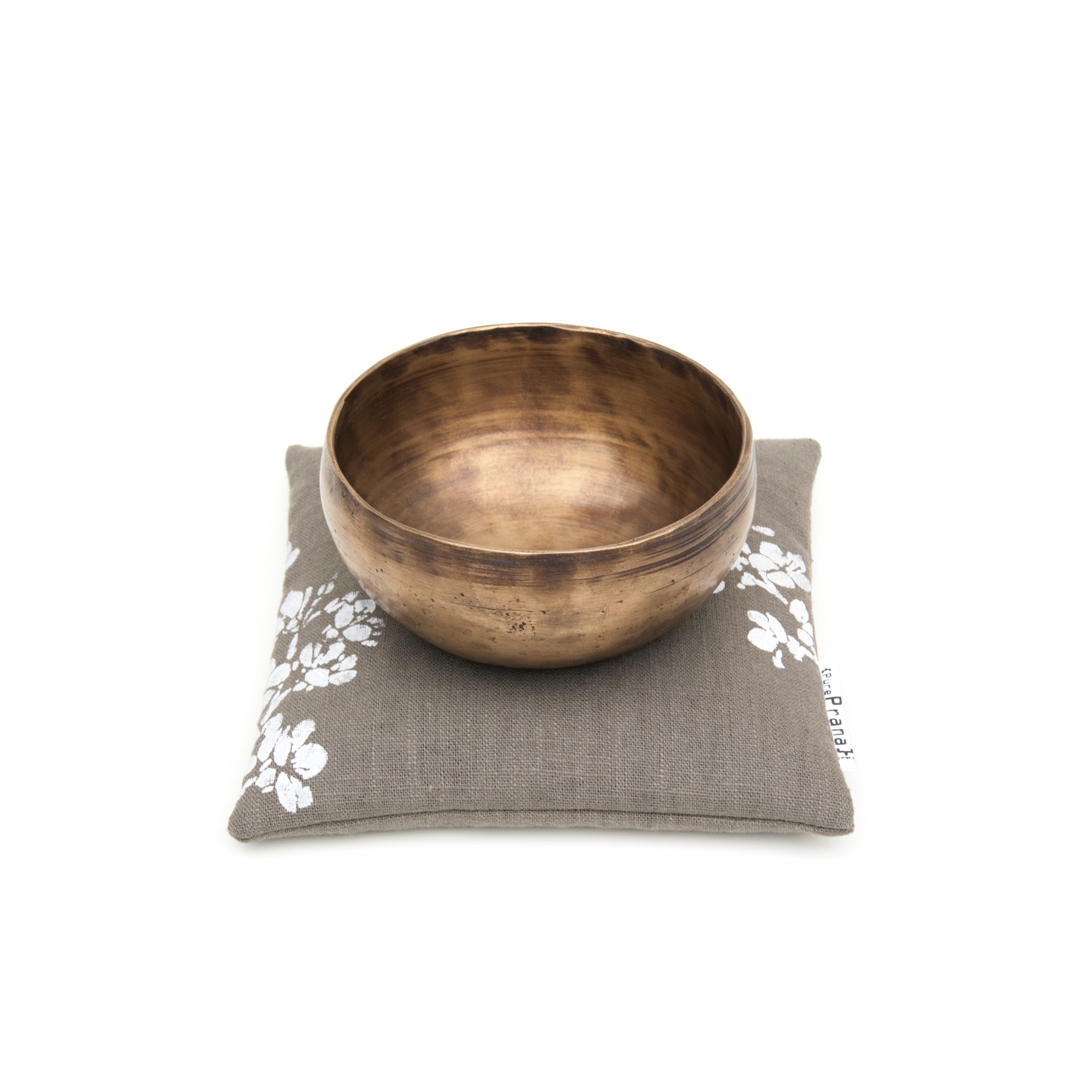 Singing bowl pillow in olive green