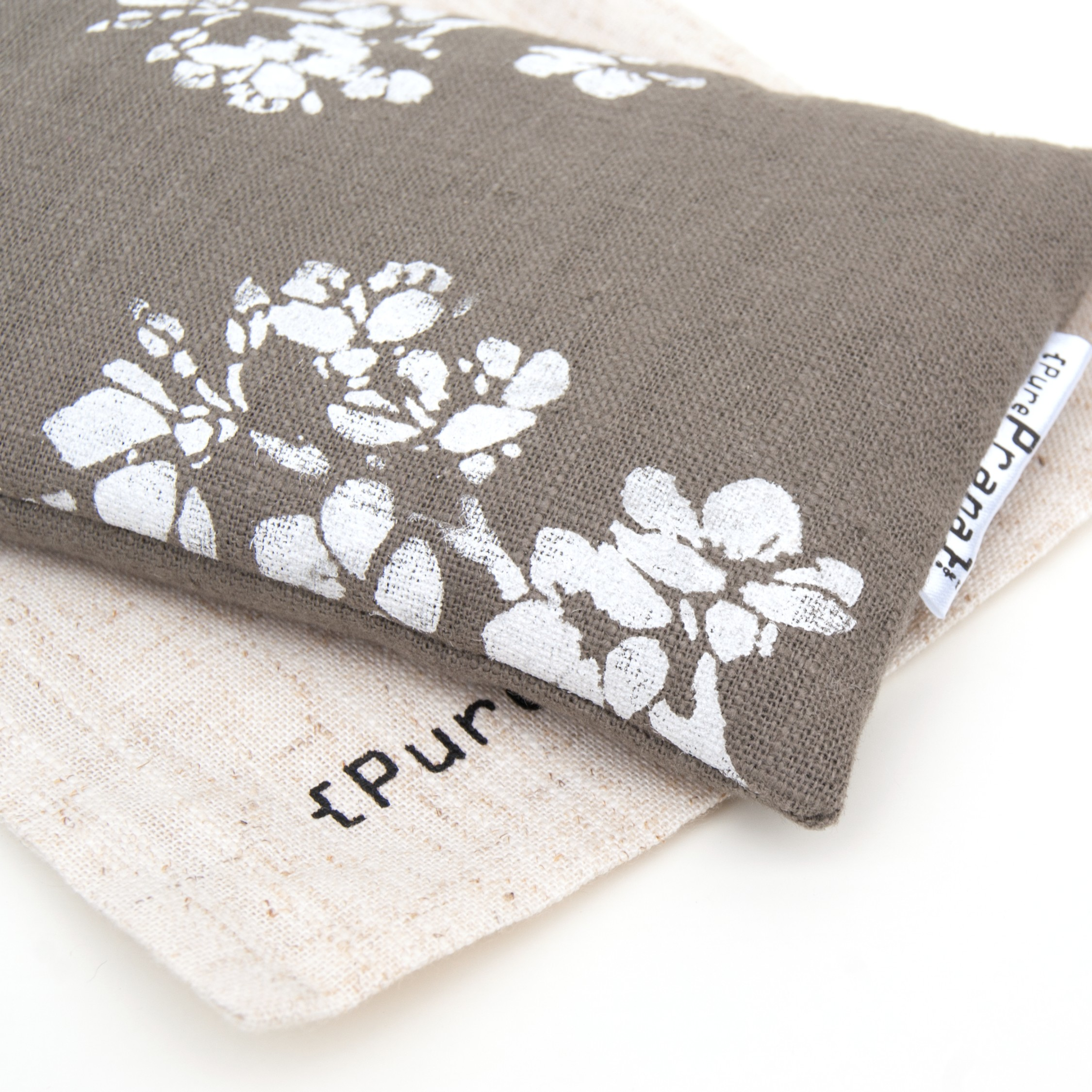 Cherry blossom print on an olive green eye pillow