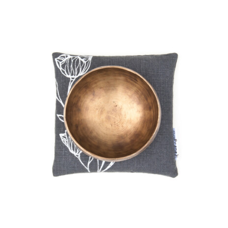 A singing bowl pillow in minimalistic scandinavian style